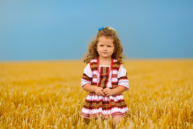 Cute little girl on wheat field